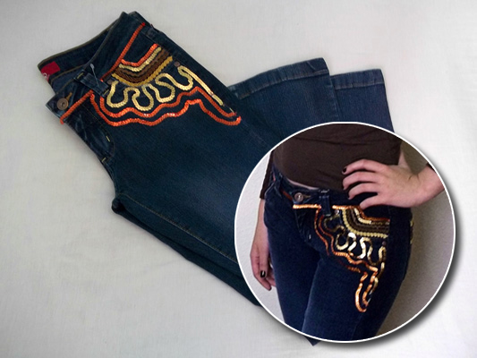 Calça jeans customizada com aviamentos HAK